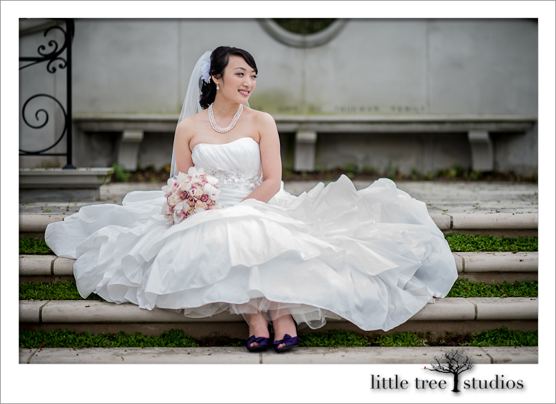 Radiant bride looks off for her photo pose at Franklin Park Conservatory in Columbus