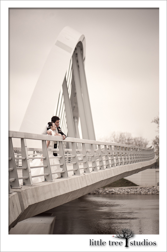 Bride, Joanna, and groom, Aaron, enjoy looking toward the future above the river in Columbus Ohio