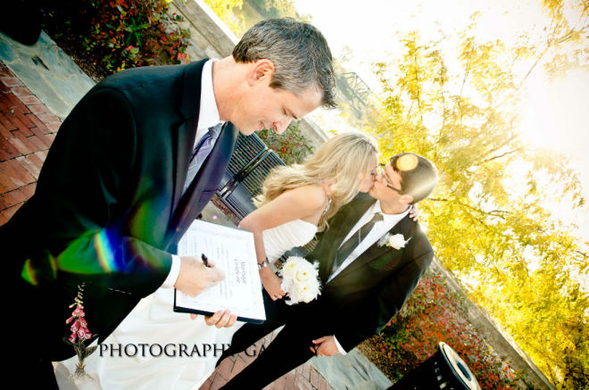 Wedding officiant,Damian King, signs marriage license in Columbus Ohio for Genevieve and Max