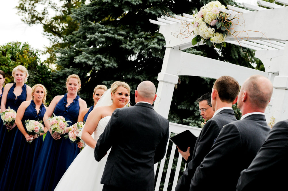 Bride, groom, bridal party, and wedding officiant, Damian King, in Columbus Ohio