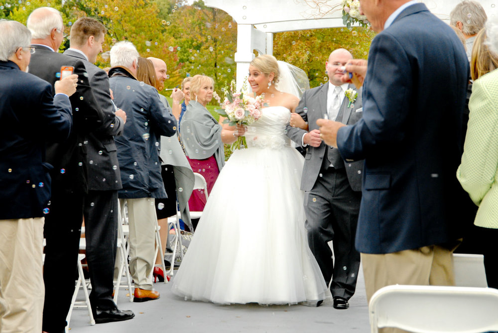 Bride and groom at wedding venue, Heritage Golf Club,in Columbus Ohio. Officiant - Damian King