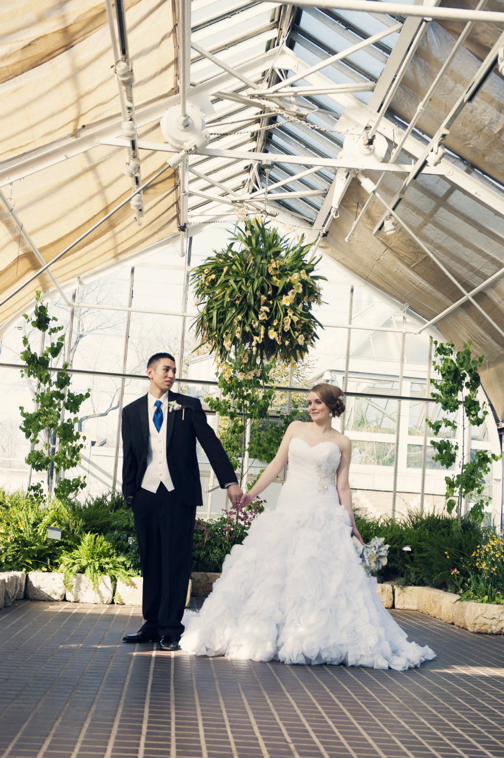 Rachel & Elias share moments in Columbus OH at wedding at Franklin Park Conservatory