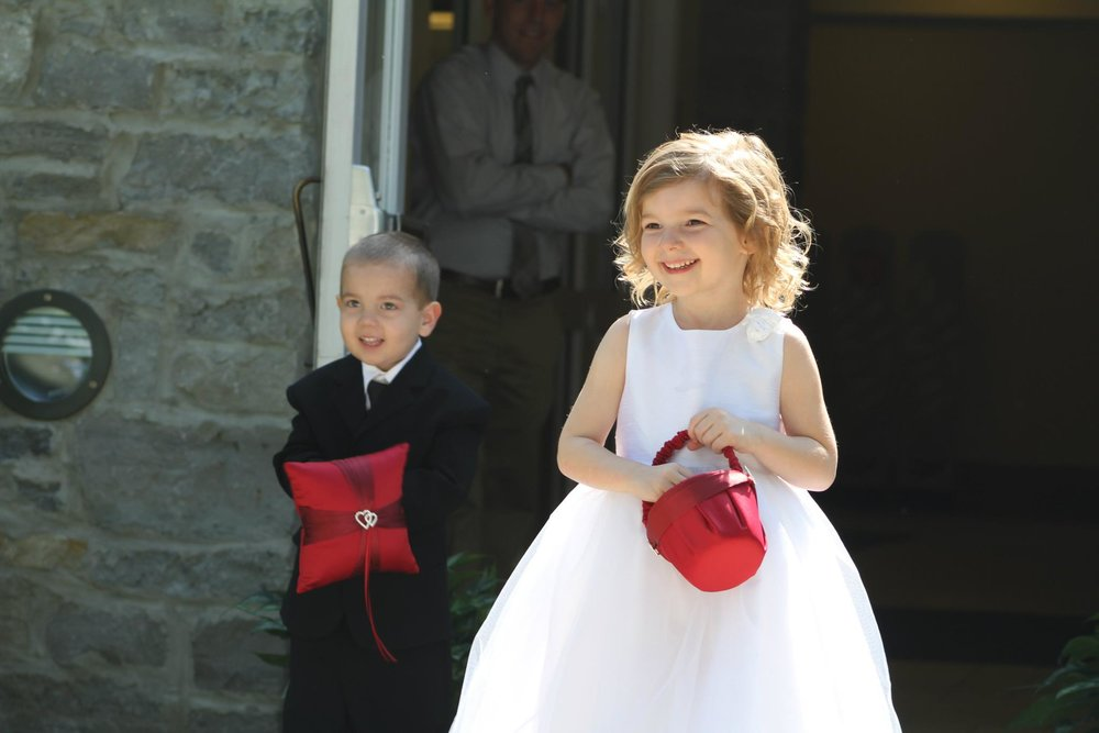 Ring bearer and Flower girl approach in Columbus Ohio as wedding officiant Damian King prepares to deliver ceremony