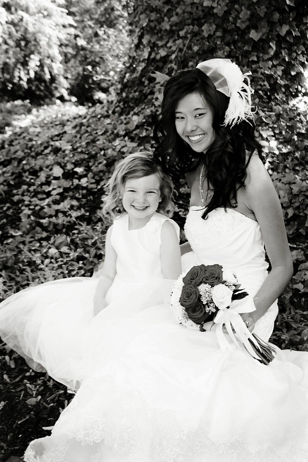 Bride with bouquet in Columbus Ohio. Flower girl smiles after wedding. Damian was officiant
