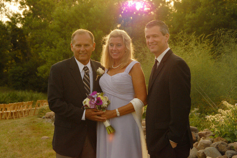 Marriage officiant Damian King stands with Darlene and Don near Columbus Ohio