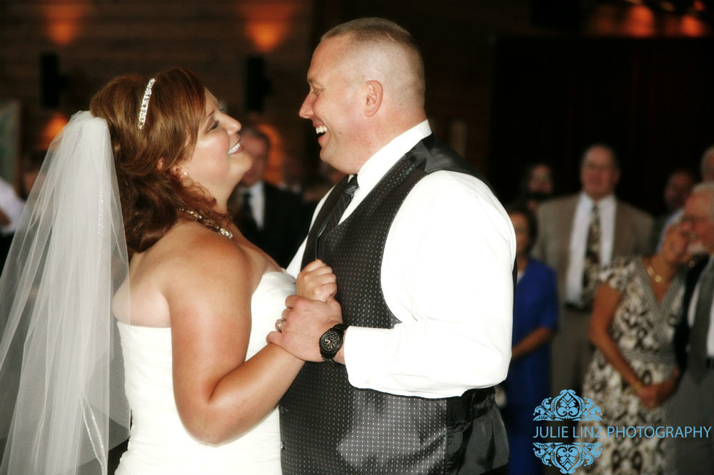 Bride and groom enjoying a dance at wedding venue Four Seasons in Columbus. Damian King, officiant