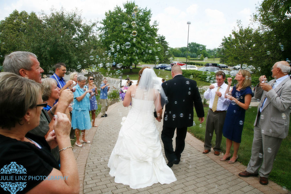 Approaching their limousine, Sarah and Brent, now married at Four Seasons wedding venue in Hilliard Ohio