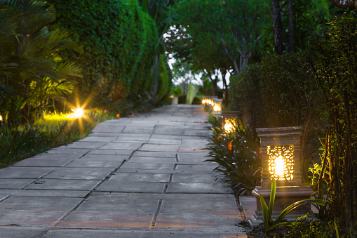 ceramic-ware-lamp-street-in-the-garden-walkway-at-twilight-picture-id863273130.jpeg