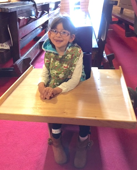 Emily in her new chair and table