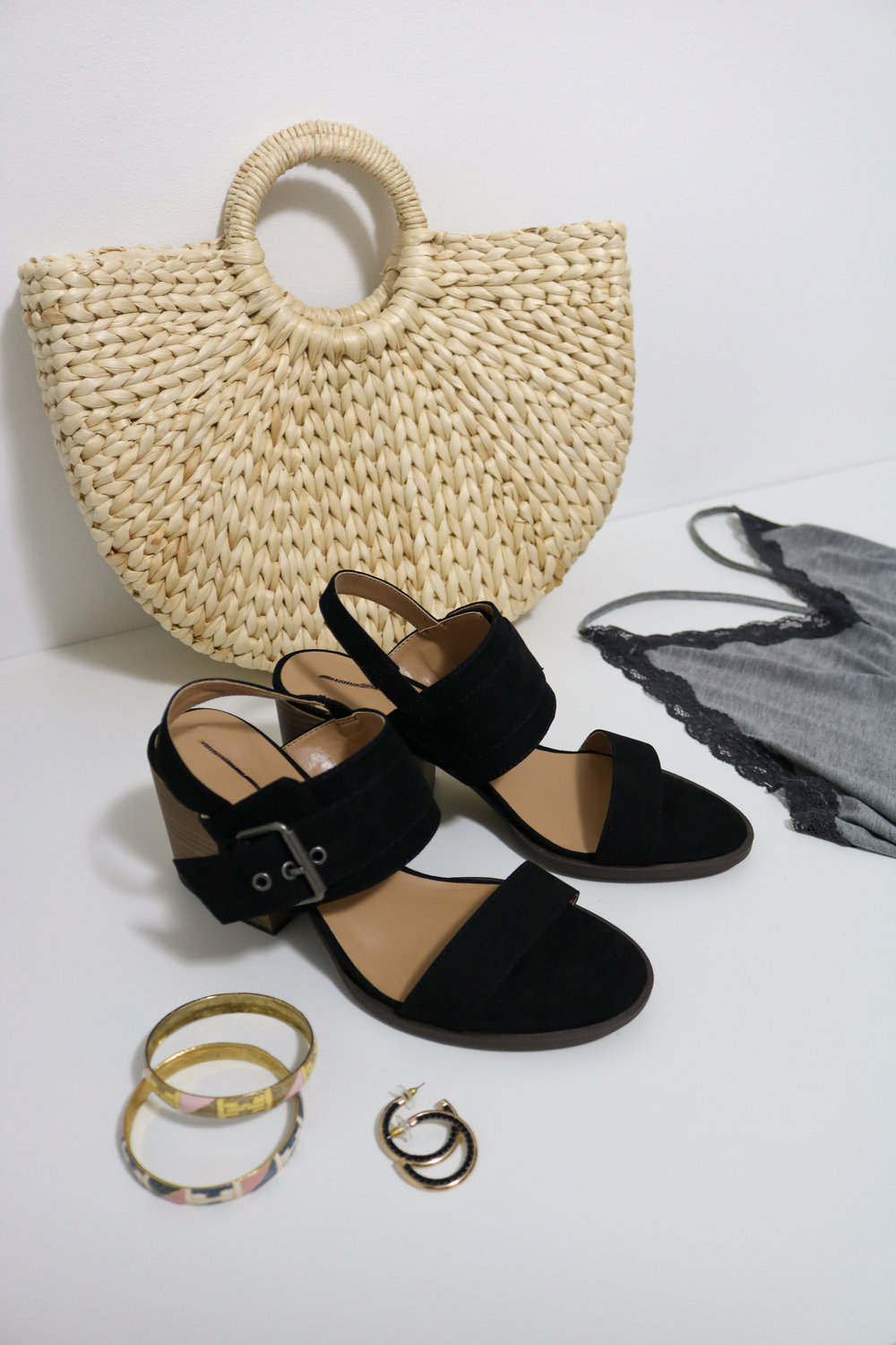 Black heels and straw circle bags are some of the newest and coolest accessories to add to a Millennial's closet. It only gets better since they were both under $15 thrifted!