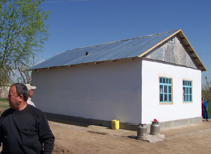 One of the nearly 200 completed transitional shelters