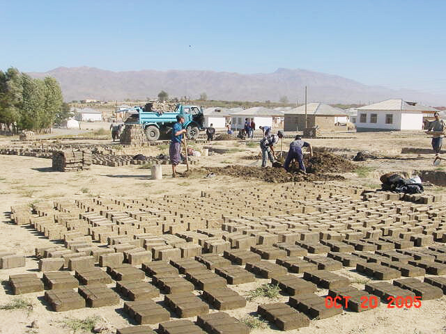 Preparing the bricks for the transitional shelters