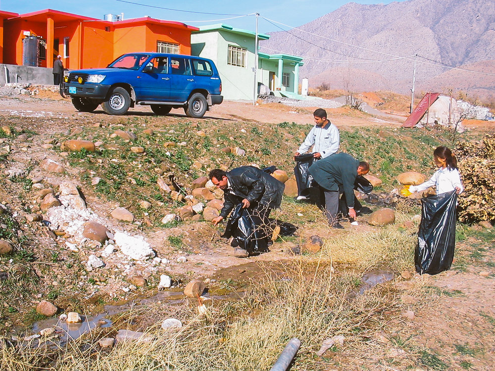 Community members collecting rubbish