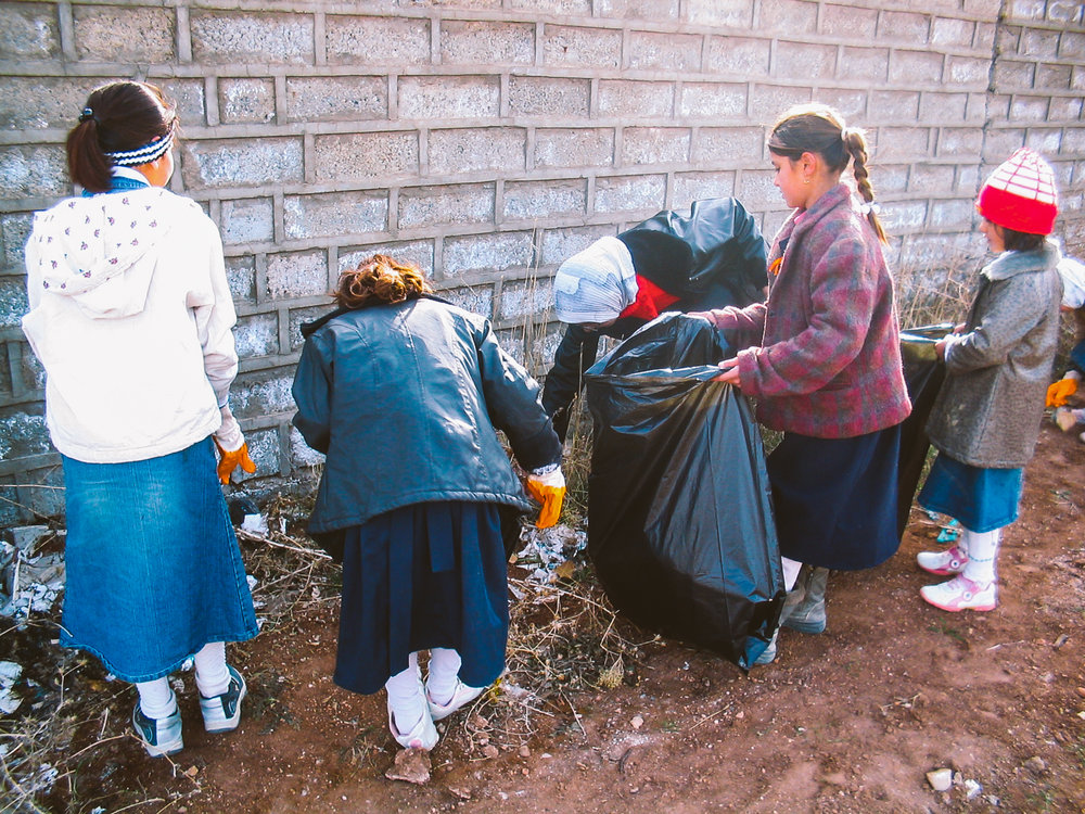 Students picking up rubbish around the school