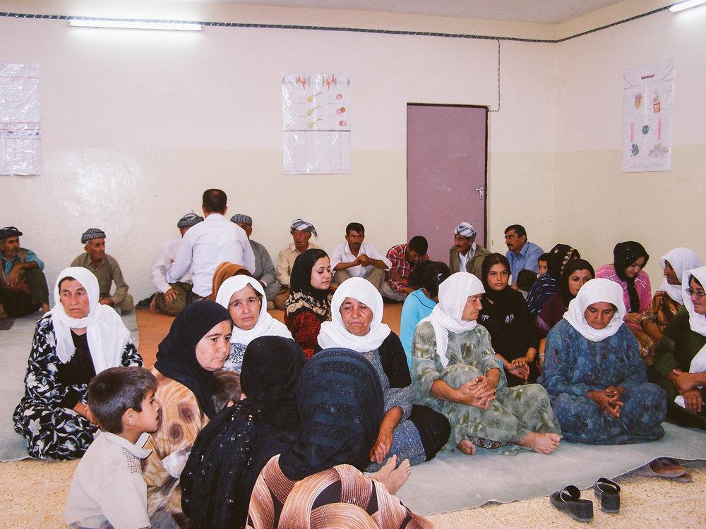 Community members attending training