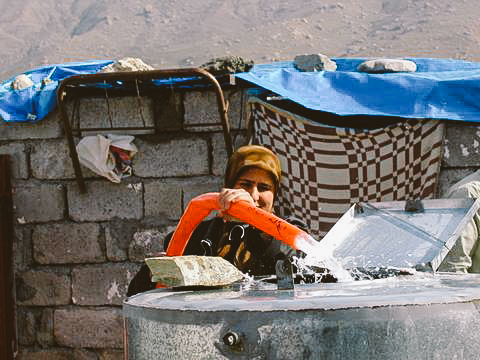Women utilizing new access to clean water