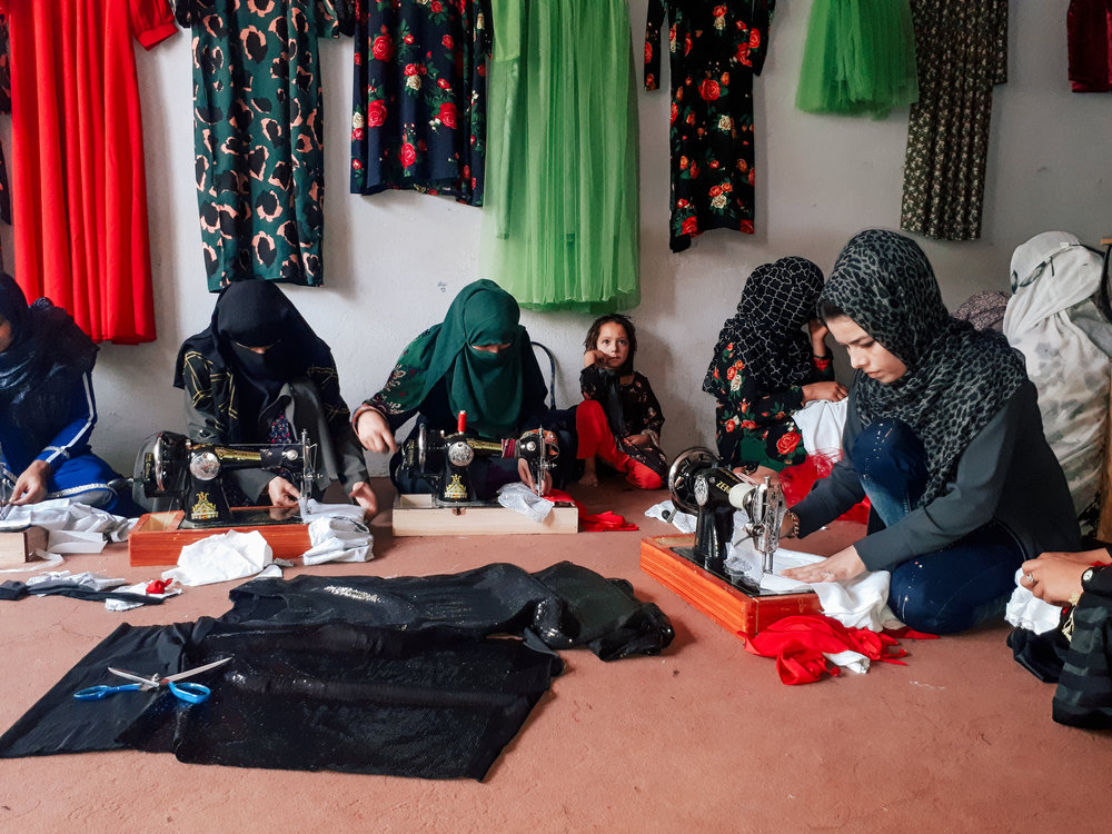 Women from Taloqan District learning tailoring skills.