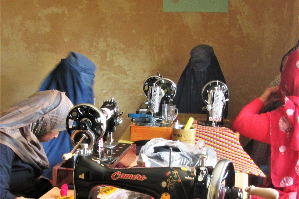 Women's group working on their handbags
