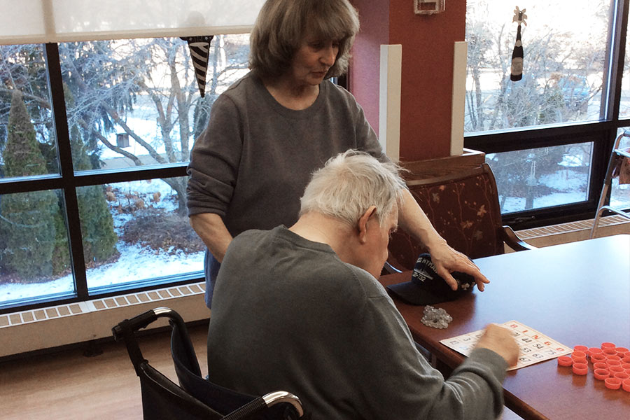 Helping with Bingo at the local nursing homes.