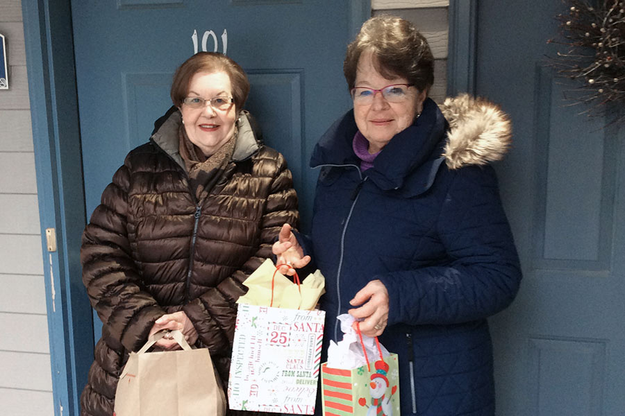Delivering food and gifts to needy families.