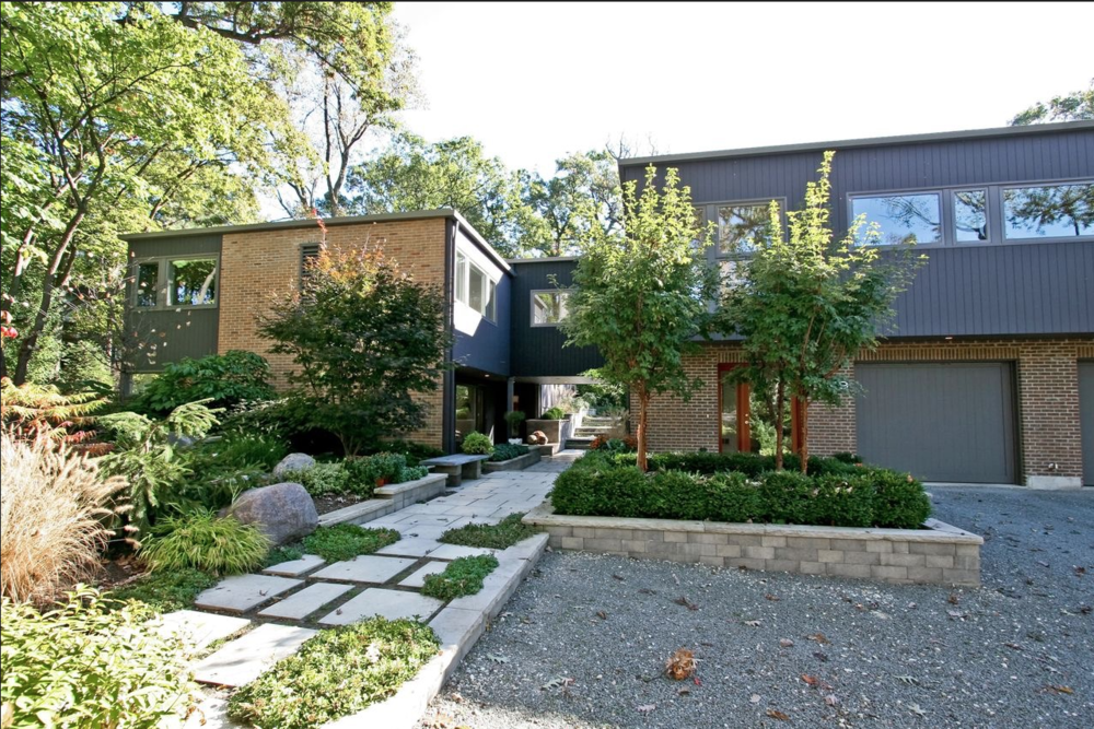 Modern architecture supports pathways to private gardens.