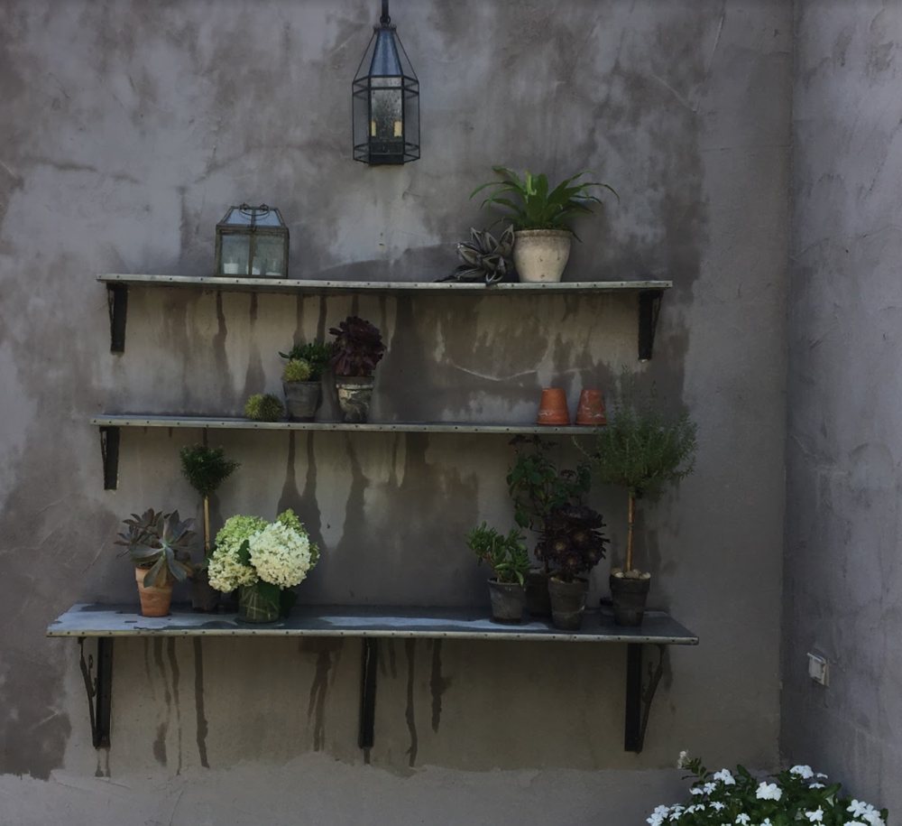 Curated: Treasures come alive on these outdoor shelves.
