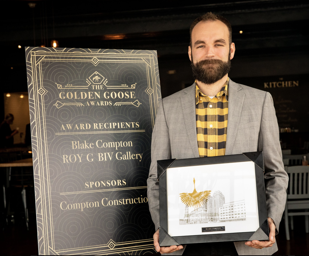 Blake Compton receiving his Golden Goose Award