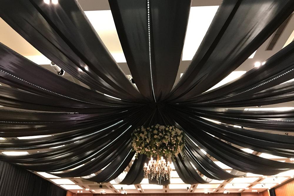 Black draping & floral ring.jpg