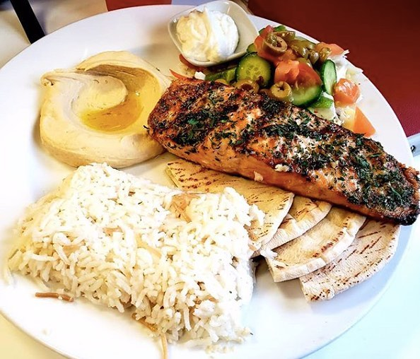 Head to @hummos.and.pita for fresh food straight from Fadi's kitchen! #salmonplate #lebanesefood PC: @danielle.247