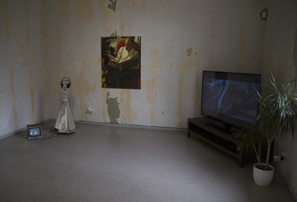 Installation view, from left: Tuomo Rainio:  Untitled (needles in air)  (2008), Kaarlo Stauffer:  Man reading a newspaper  (2011), Joakim Pusenius:  Anamnesis  (2014)