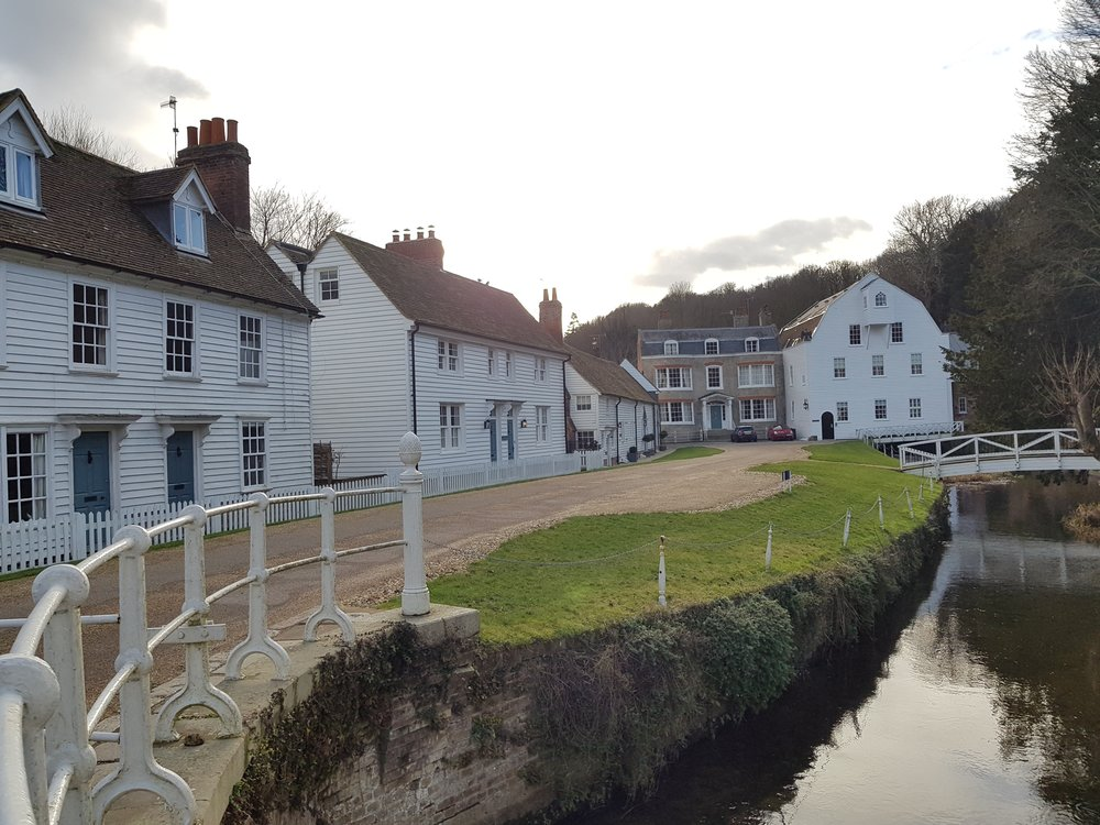 Riverside court with feature gable house at the end creates a surprise opening out, off High Street where the river crosses the High Street. -