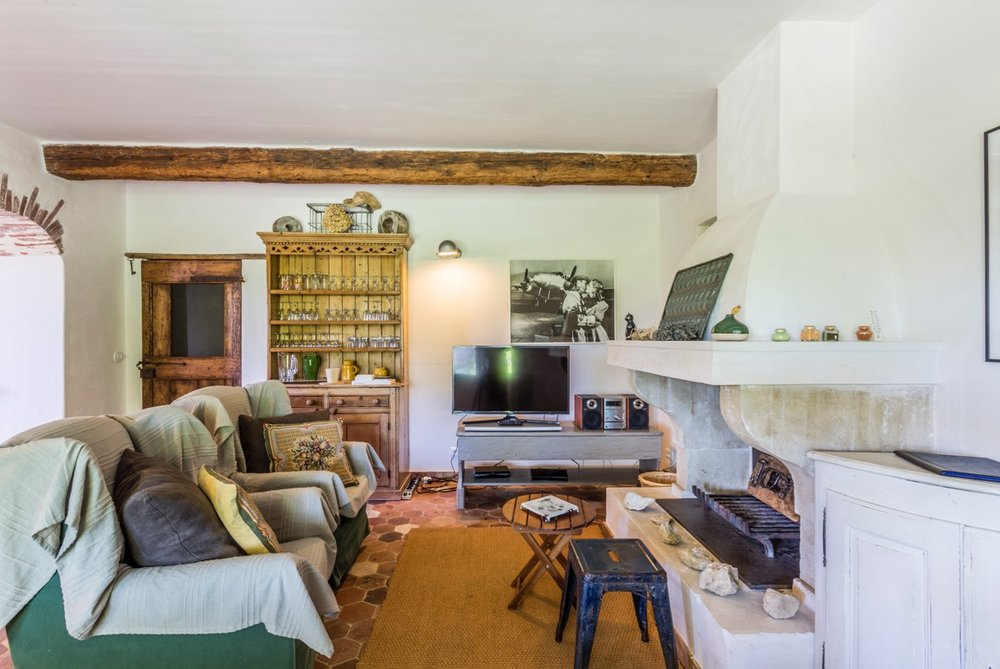 Sitting Room - A sitting room with open provençal fireplace and comfortable armchairs completes the ground floor accommodation. Here you have access to Sky TV, Netflix, Smart TV, a dvd/cd player, books, magazines and board games.