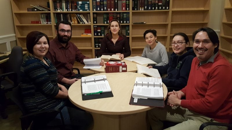 Nunavut law students Alanna Copland, left, Pascal MacLellan, Tagalik Eccles, Angnakuluk Friesen, Samantha Barnes and Guy d'Argencourt pore over their legal studies in the Nunavut Law Program. Michele LeTourneau/NNSL photo