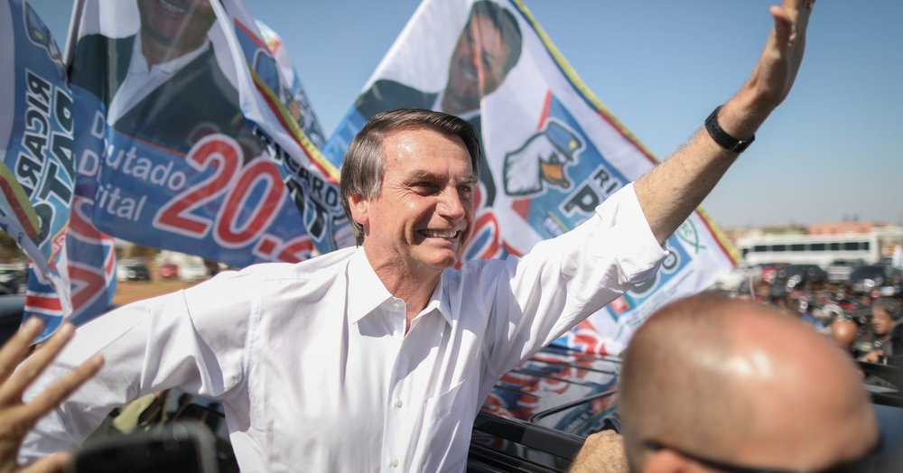 Picture by Andre Coelho | Bloomberg | Getty Images   Jair Bolsonaro, PSL Candidate, waving to supporters at a political rally in Taguatinga, Brazil, on Wednesday, September 5th, 2018.