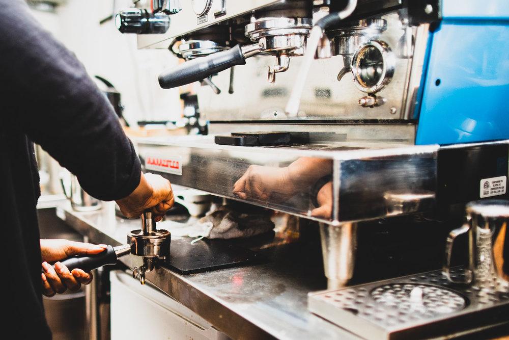 Preparing the cappuccino.
