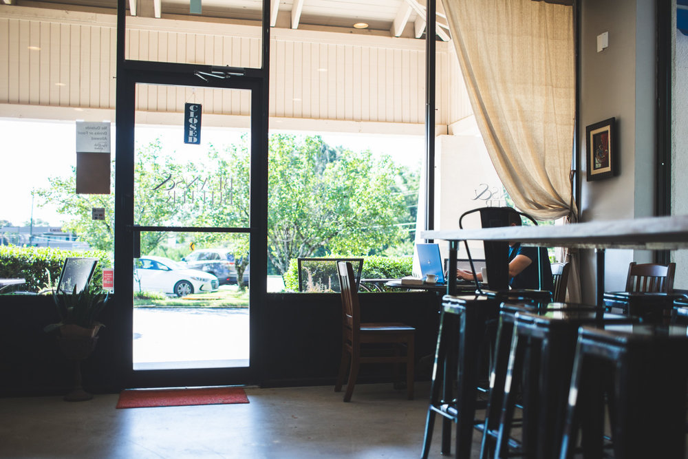 Interior of Beans & Butter Coffeehouse. There is plenty of seating inside.