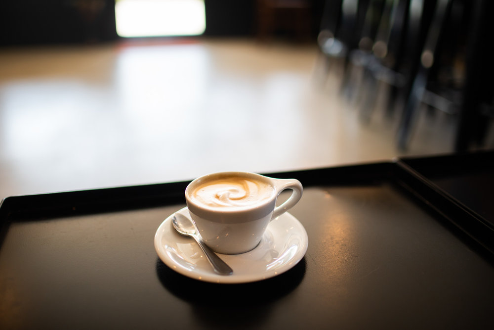 Cappuccino is served. Beans & Butter Coffeehouse sources its coffee from Athens-based  1000 Faces Coffee .