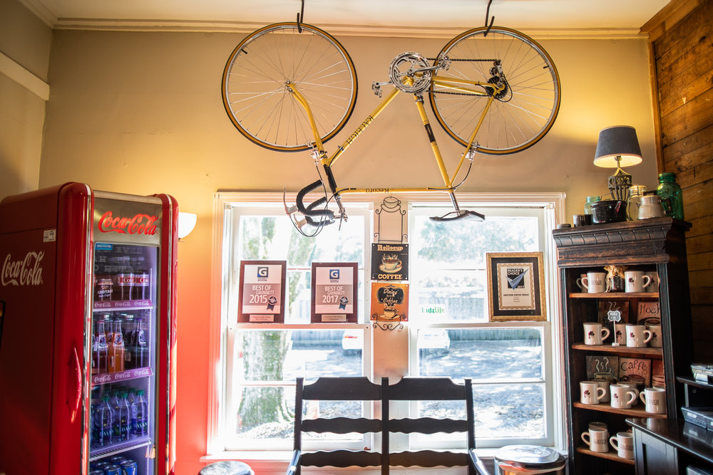 Interior of Grayson Coffee House. The bicycle was donated by a member of a cycling team which met at Grayson Coffee House regularly.
