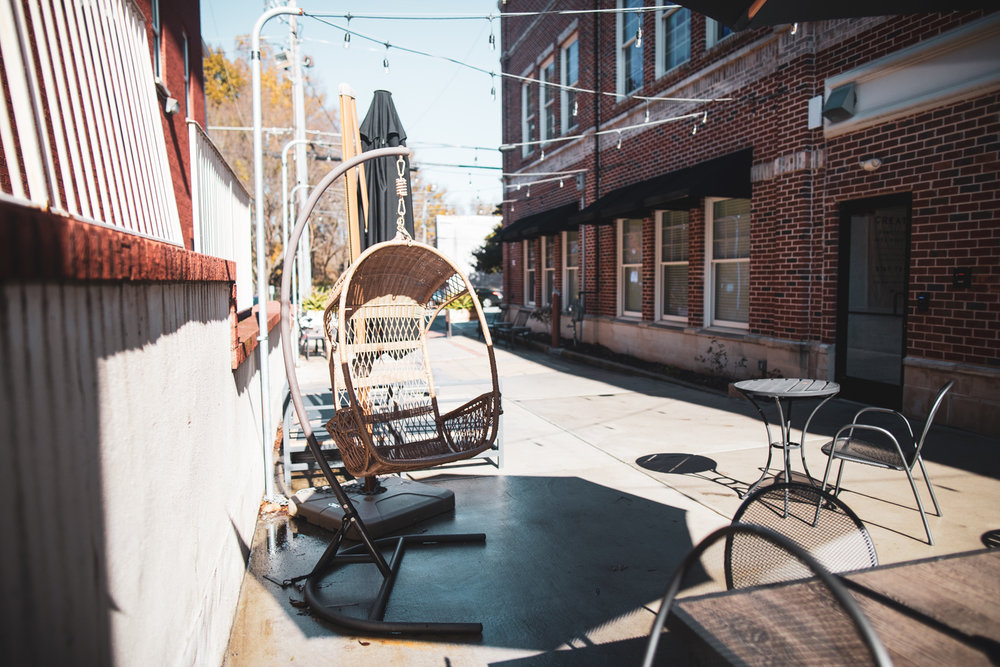Outdoor seating at Valor Coffee's location, sharing it with the  Thrive Coworking  space.
