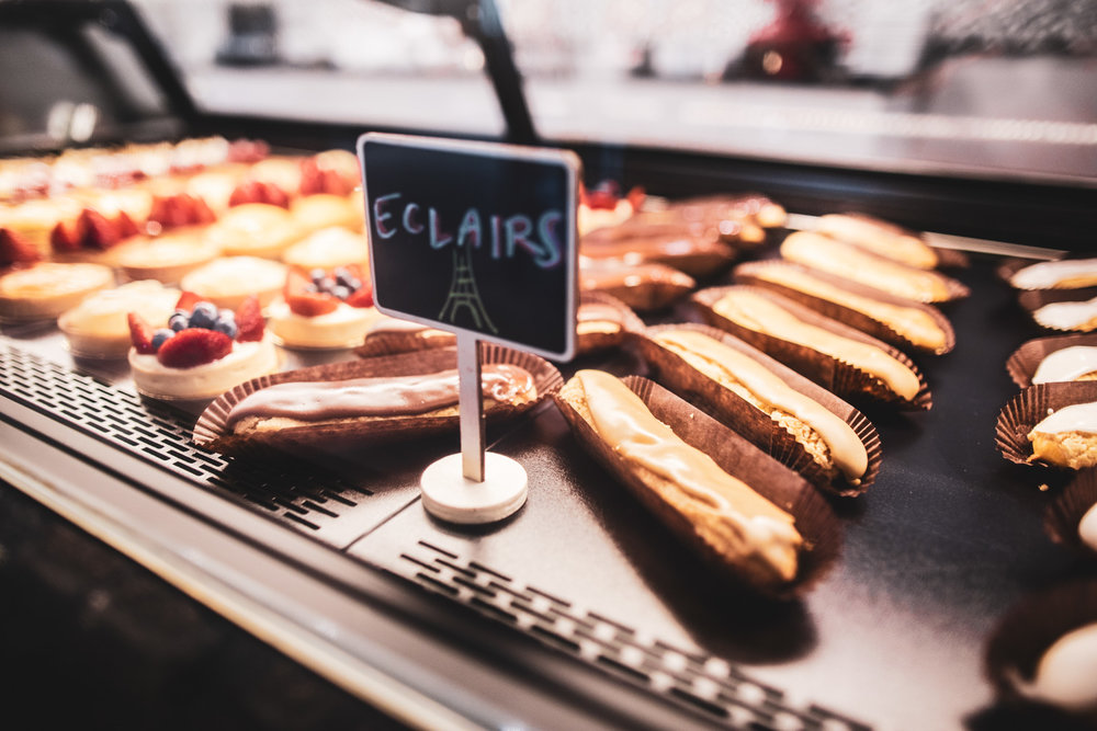 Various eclairs on display.