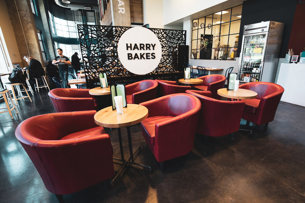 Comfortable chairs next to the Harry Bakes Cafe. Note: Harry may be seen in the background of this image at left.