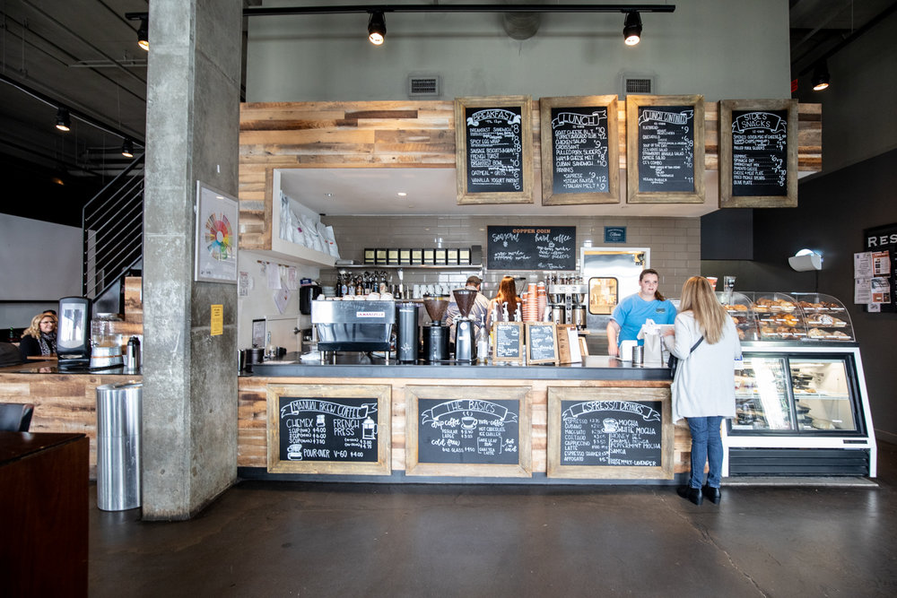 Inside Copper Coin Coffee. There are coffee options: the basics, espresso drinks, and manual brew coffee.