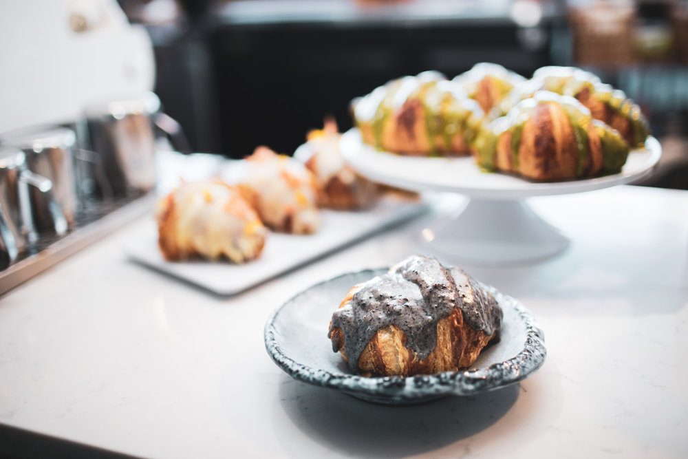 Desserts at Momo Cafe. At front: the black sesame croissant. At left: the chocolate citrus croissants. At back right: the matcha croissants.