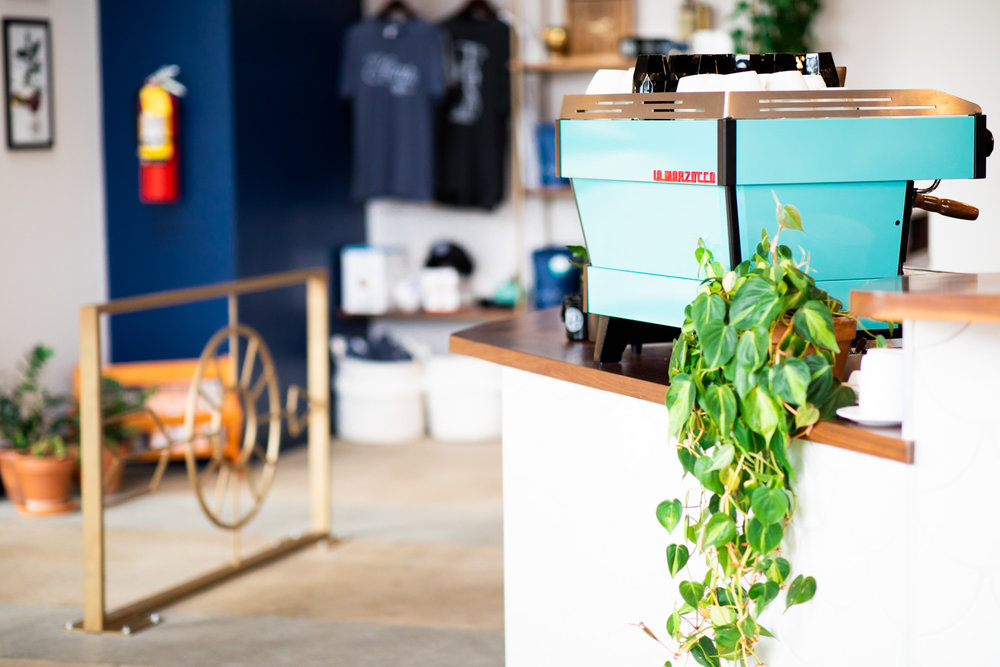Details from inside East Pole. The cyan/light blue espresso machine bolsters the nautical theme inside East Pole.