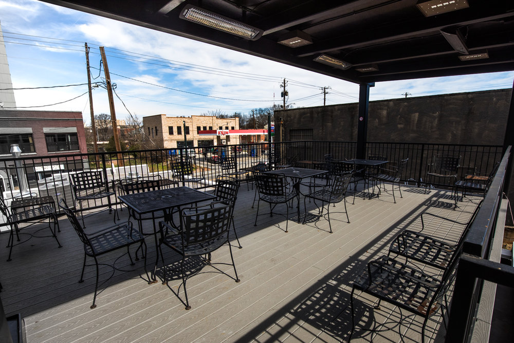 The covered patio on the second floor at Docent Coffee.