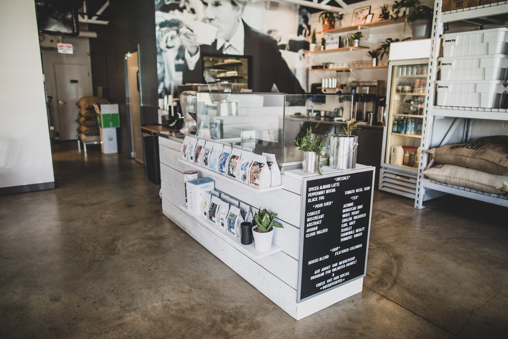 Wide-angle view of the interior of Docent Coffee. The coffees on the two rows  are profiled in this section .