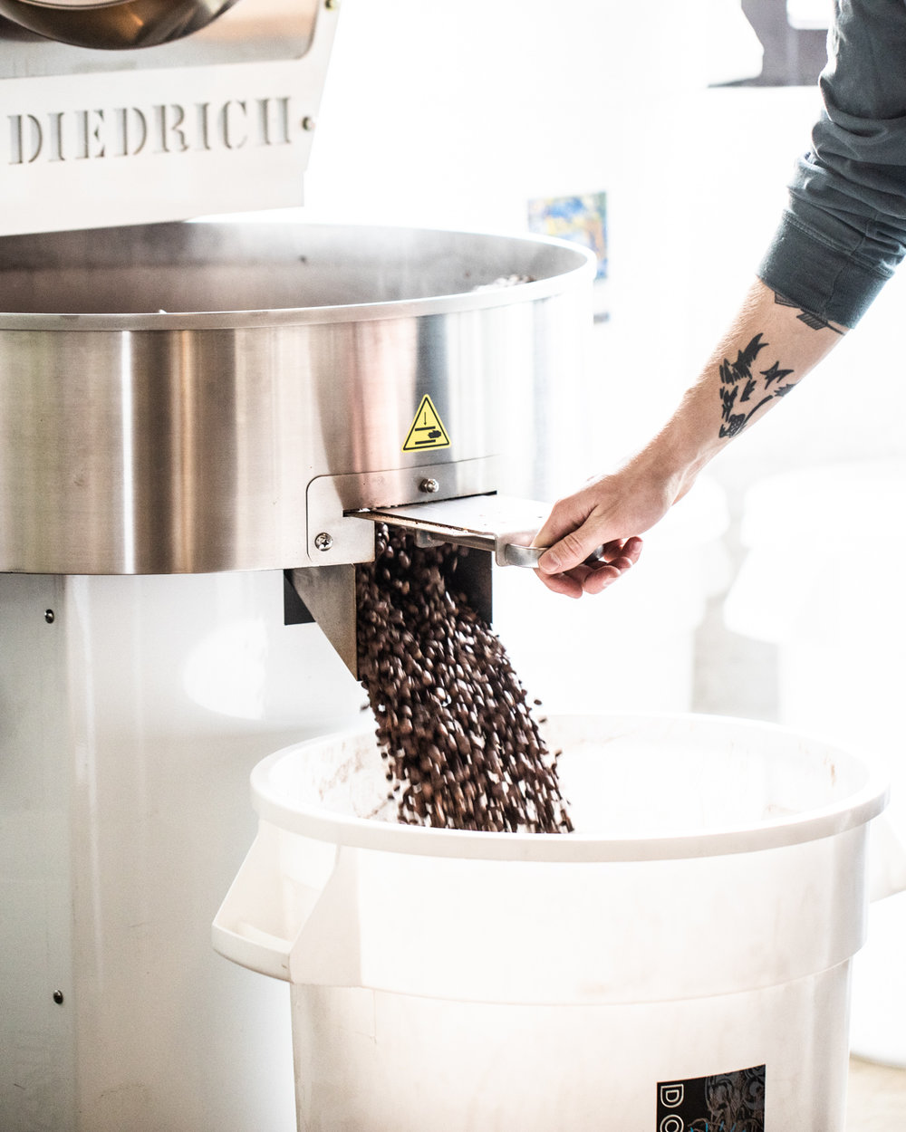 Final step before mixing the beans and packaging—collecting the cooled beans.