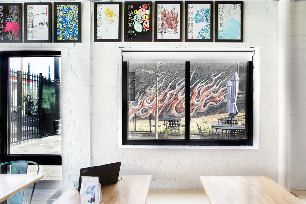 Interior of Docent Coffee. The view through the window is toward the outdoor courtyard (patio) of Docent Coffee.
