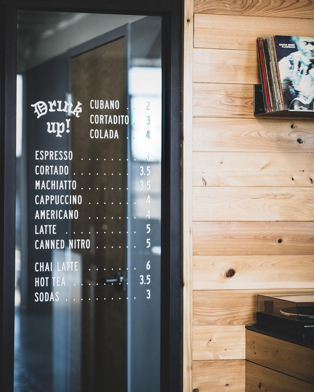 The drink menu is printed on the door.