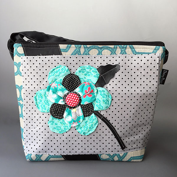 Daisy Bags   I manipulate fabric while playing with textures & colors to create one of a kind fiber handbags.  A modern take on traditional techniques of appliqué & quilting are used to give each bag its distinct characteristics — Jill Scales   www.daisybags.com